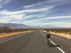 Biker traveling down highway